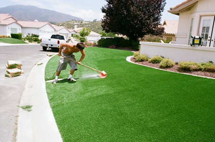 sand brushed into synthetic grass